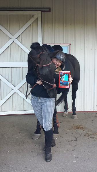 Gail Anne Hopp Day with her trusted mount, and my memoir.